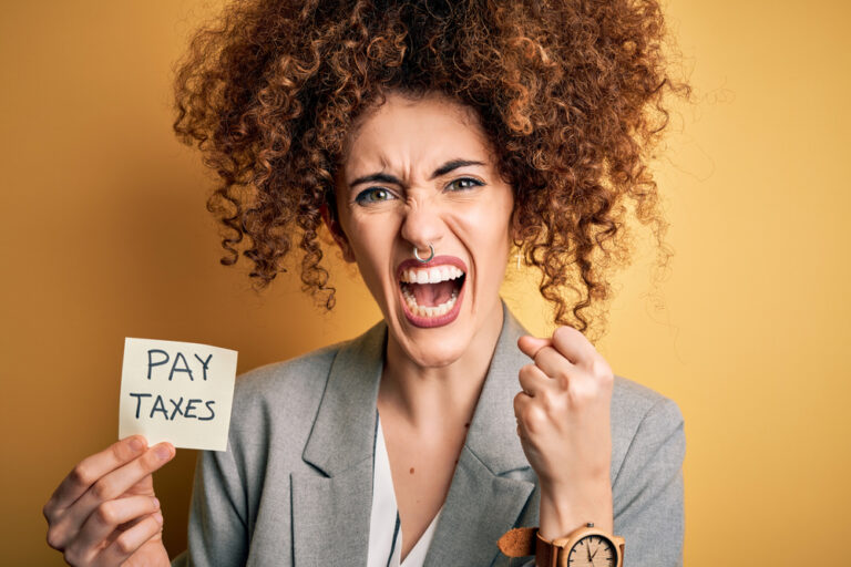 Angry woman paying taxes.
