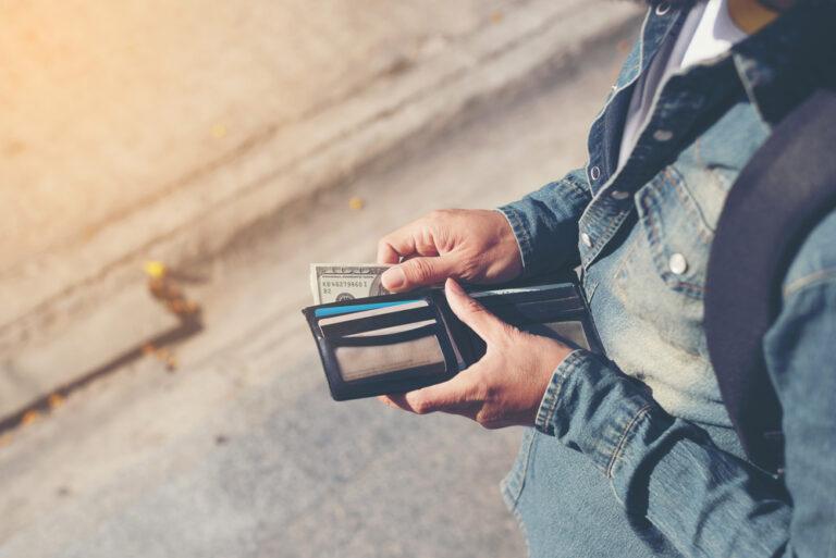 Opening wallet.